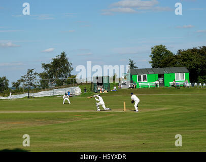Cricket match being played in Derbyshire England - Stock Photo