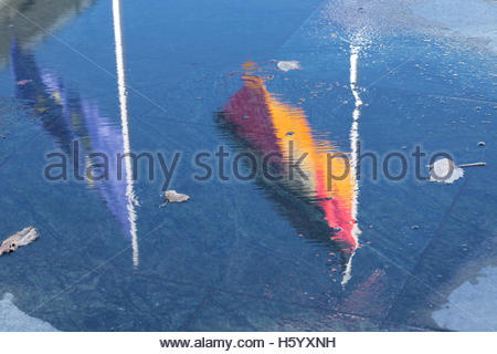 German and European Flag reflected in a Puddle conceptual photography - Stock Photo