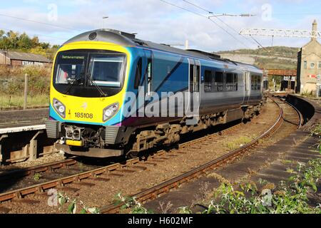 Siemens Desiro class 185 diesel multiple unit in new First TransPennine livery leaving Carnforth station with train - Stock Photo