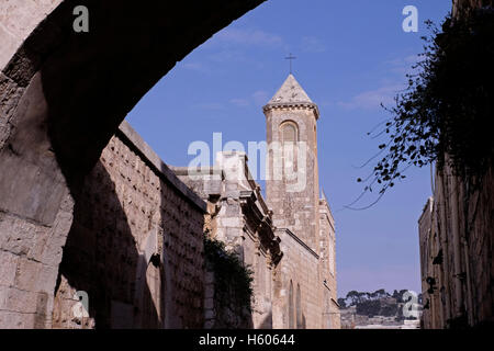 View toward the bell tower of the  Roman Catholic Church of the Flagellation from the span of the Ecce Homo arch - Stock Photo