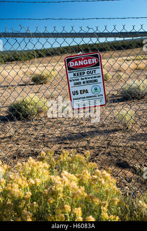 Mariano Lake, New Mexico - A sign warns of radiation danger on the site of an abandoned uranium mine on the Navajo - Stock Photo