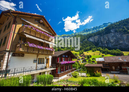 Famous Lauterbrunnen valley with gorgeous waterfall and Swiss Alps in the background, Bernese Highlands, Switzerland - Stock Photo