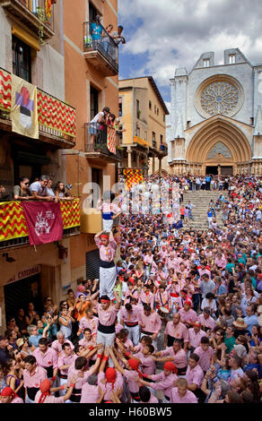 Xiquets de Tarragona.'Castellers' human tower walking, a Catalan tradition.Festa de Santa Tecla, city festival. - Stock Photo