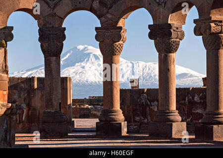Columns of the Zvartnots Temple in Yerevan, Armenia and the Mount Ararat in the background. - Stock Photo