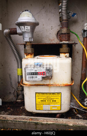 Analog domestic gas meter and shut-off valve before the installation of a smart meter - Stock Photo
