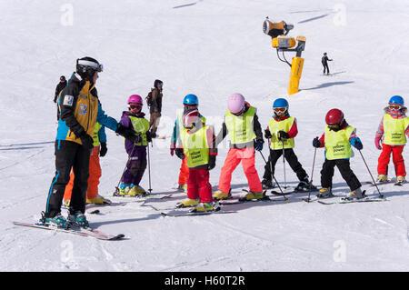SOLDEN, AUSTRIA, MARCH 4, 2016: Ski school for children in Solden ski resort in Austrian Alps - Stock Photo