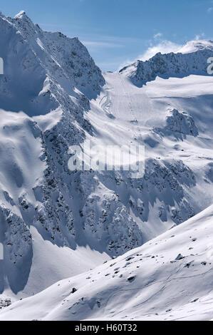 Ski lift, run and piste on Rettenbach Glacier in Solden ski resort in Otztal Alps in Tirol, Austria - Stock Photo
