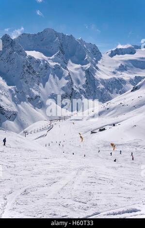 Ski lifts, skiers and pistes to Rettenbach Glacier in Solden ski resort in Otztal Alps in Tirol, Austria - Stock Photo
