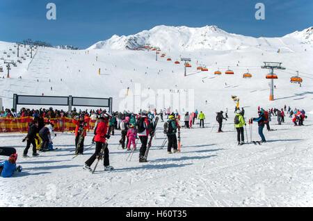 SOLDEN, AUSTRIA - MARCH 4, 2016: Crowd of skiers and chairlifts in Alpine ski resort in Solden in Otztal Alps, Tirol, - Stock Photo