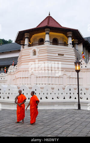 Monks standing outside the Temple of the Tooth, Kandy, Sri Lanka - Stock Photo