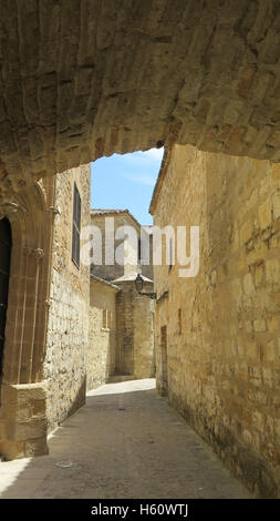 Narrow street in Baeza in province of Jaen, Andalusia - Stock Photo