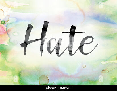 The word 'Hate' painted in black ink over a colorful watercolor washed background concept and theme. - Stock Photo