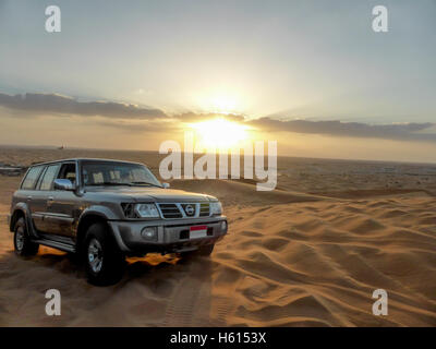 Car ride during sunset time in Safari, Dubai, UAE - Stock Photo