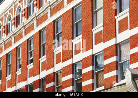Facade of Victorian style high street block in London - Stock Photo