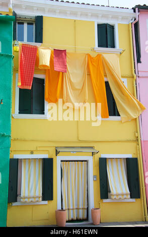 Colourful fishermen's cottages on Burano island in the Venice lagoon, Italy - Stock Photo
