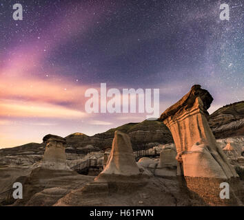 The Big Dipper, at left, and Little Dipper with Polaris, centre, over the Hoodoos on Highway 10 along the Red Deer - Stock Photo