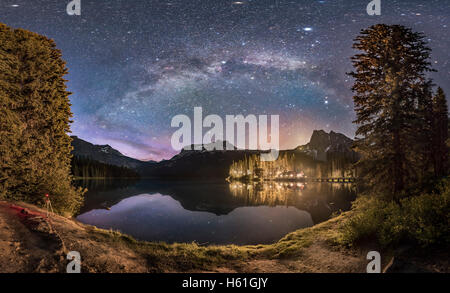 The Milky Way arching over Emerald Lake and Emerald Lake Lodge in Yoho National Park, BC. This was on June 6, 2016 - Stock Photo