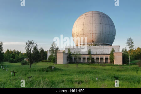 Old giant dome of a radar antenna of a Russian military base - Stock Photo