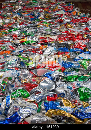 aluminium tin cans compressed for recycling. - Stock Photo