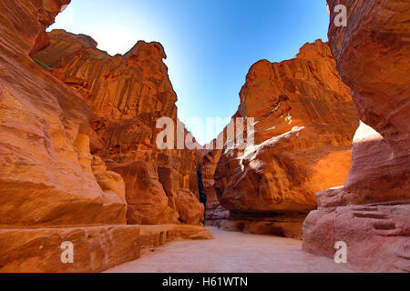 Sandstone cliiffs of the Siq canyon entrance to the city of Petra, Jordan - Stock Photo