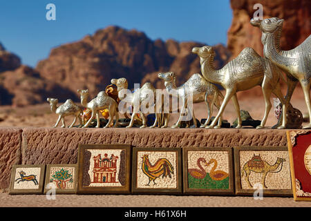 Camel souvenirs on sale at the Urn Tomb of the Royal Tombs in the rock city of Petra, Jordan - Stock Photo