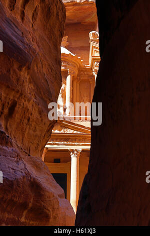 View of the Treasury, Al-Khazneh, from the Siq, Petra, Jordan - Stock Photo