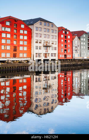 Colorful old wooden houses stand along Nidelva river. Trondheim, Norway - Stock Photo