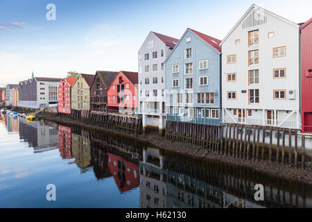 Colorful old wooden houses stand along Nidelva river coast. Trondheim, Norway - Stock Photo