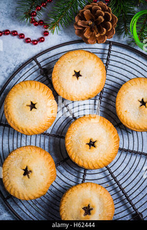 Traditional english minced pies for Christmas on festive decorated table - Stock Photo