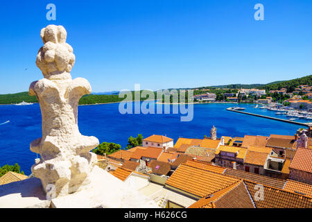 Rooftop view of the old town of Korcula, with roofs, houses and boats, in Dalmatia, Croatia - Stock Photo