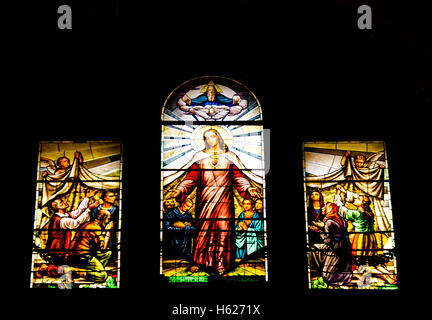 Stained glass window in the Basilica di Santa Margherita Italy depicting Jesus preaching - Stock Photo