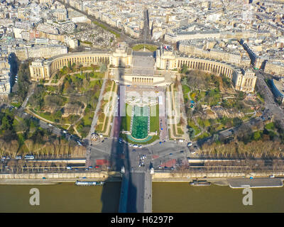 the bird-fly view from the eiffel tower with it's shadow on the trocadero gardens and seine river - Stock Photo