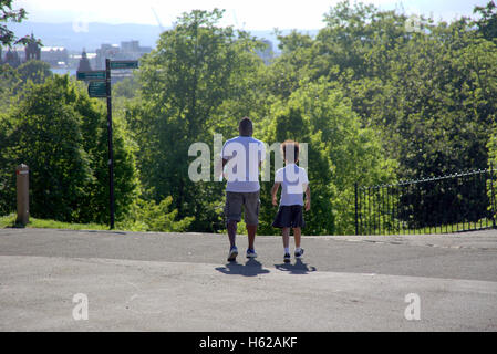 Black father and daughter tourists Glasgow kelvingrove  park which contains both the university and the museum in - Stock Photo