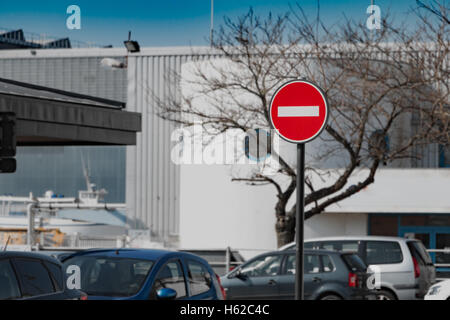 No entry sign in a a parking with blue sky - Stock Photo