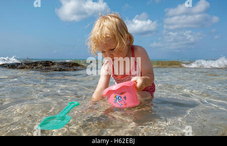 Little girl playing in the sea - Stock Photo