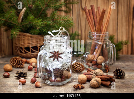 Christmas composition. Winter spices and ingredients for cooking the Christmas meal. Cinnamon sticks, hazelnuts, - Stock Photo