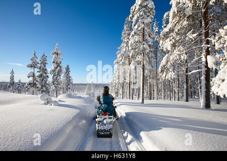 Traveling Lapland with snowmobile - Stock Photo