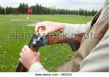 Over and under shotgun stock photo royalty free image for 12 gauge shotgun lying on the floor