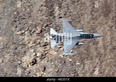 Royal Danish Air Force F-16 in flight over California's Mojave Desert. - Stock Photo
