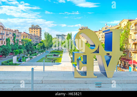 The view on the Cafesjian monument garden through the sculpture inscription Love by American artist Robert Indiana - Stock Photo