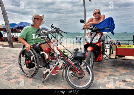 motorised wheelchair. Disabled man with an electric wheelchair - Stock Photo