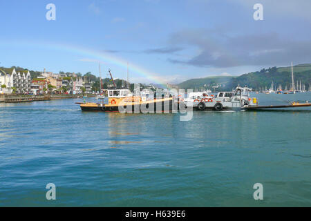 The Dartmouth Lower Ferry for cars and foot passengers plies between the town and Kingswear seen in mid river with - Stock Photo