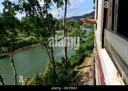 View from the Train between Bangkok to Nam Tok over the River Kwai Bridge - Stock Photo