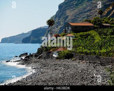 The pebble beach of Faja dos Padres on the Portuguese island of Madeira - Stock Photo