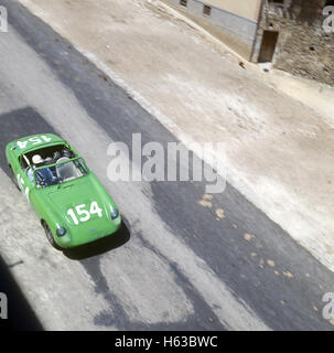 154 Rauno Aaltonen and Clive Baker in a Austin Healey Sprite finished 15th in the Targa Florio 9 May 1965 - Stock Photo