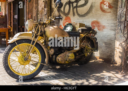 Old motorbike in the streets of Jaffa in Israel - Stock Photo
