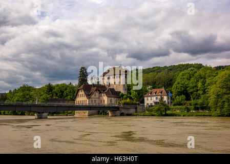 View of the bridge and castle in Kaiserstuhl of Switzerland with the Rhine river in flood - Stock Photo