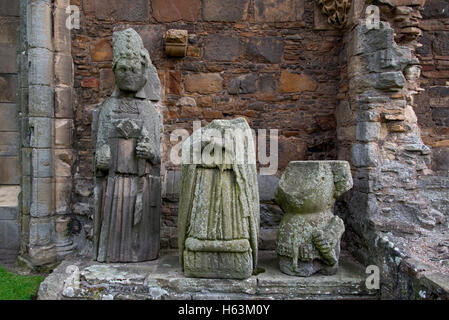 The carved stone figure of Bishop Innes in the ruins of Elgin Cathedral, Moray, Scotland, UK. - Stock Photo