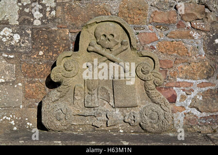 Headstone showing symbols of mortality in the graveyard of Elgin Cathedral, Moray, Scotland, UK - Stock Photo