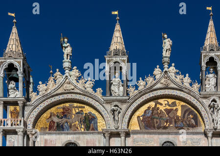 Sunshine glinting off the mosaic panals on St Mark's Basilica in Venice in northern Italy. The Basilica Cattedrale - Stock Photo
